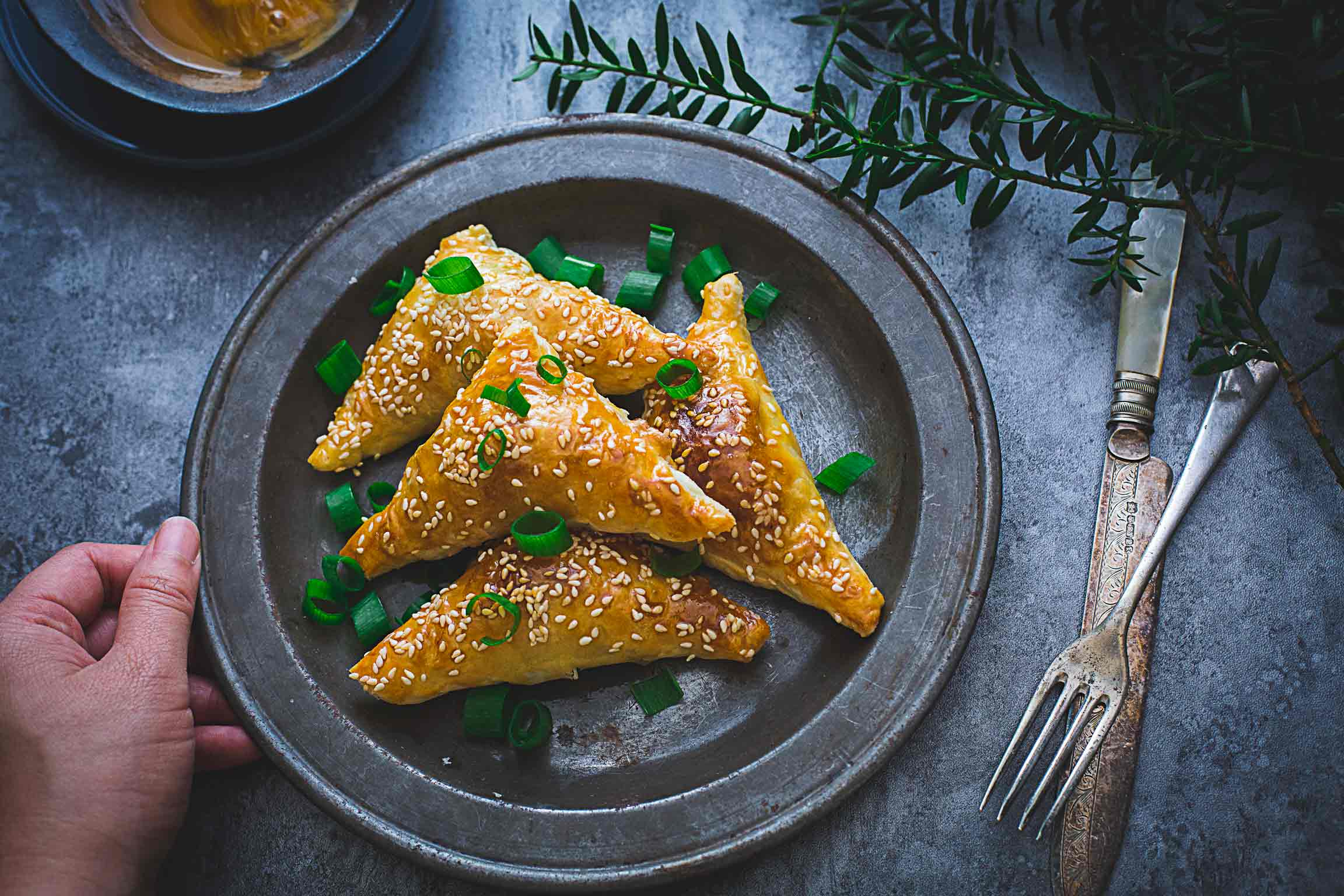 five spice pork and onion pastry triangles